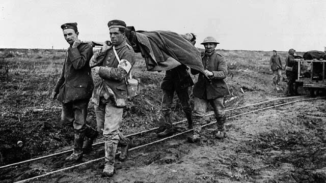 German POWs carry Canadian wounded at Vimy Ridge